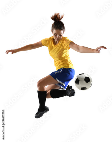 Fotografija Female Soccer Player Kicking Ball