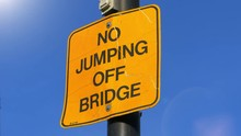 Yellow Sign Close Up, No Jumping Off Bridge Message, Blue Sky Background