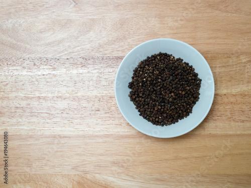 Fotografie, Obraz  Overhead shot of peppercorn in porcelain bowl