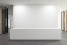 White Reception In A White Office Lobby