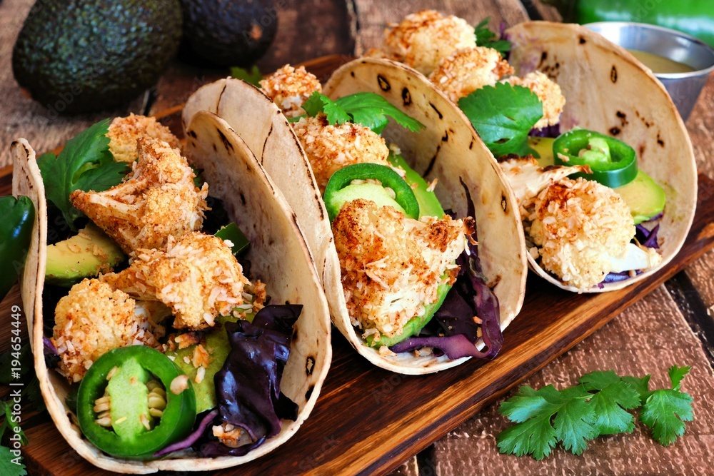 Fototapety, obrazy: Roasted coconut cauliflower tacos. Healthy, vegan meal. Close up, side view on a wooden background.