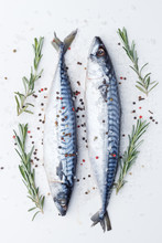 Raw Sardines On A Table With I...