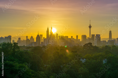 Majestic sunrise over Petronas Twin Towers and surrounded buildings in downtown Kuala Lumpur, Malaysia