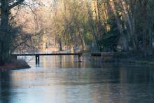 Old Swing Bridge On A Frozen Lake In Aschaffenburger Park Schoenbusch