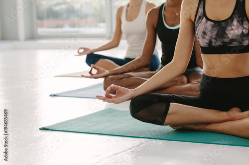 Door stickers Yoga school Females meditating in Padmasana at yoga class