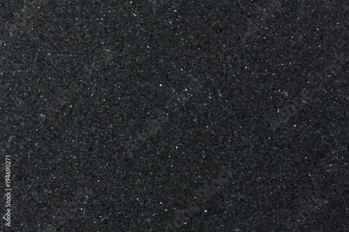 Natural black granite background.