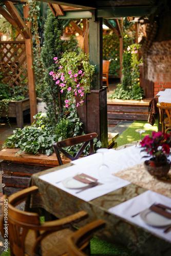 Aluminium Prints Bonsai Garden restaurant with setting tables