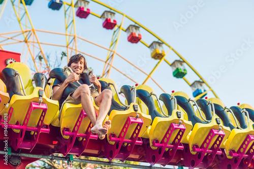 Poster Amusementspark Beautiful, young man having fun at an amusement park