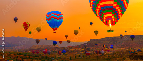 Hot air balloons sunrise landing in a mountain