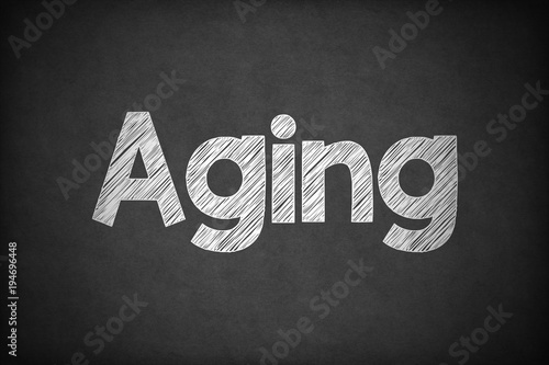 Aging on Textured Blackboard. Canvas Print