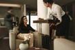 Leinwanddruck Bild - Business lounge staff serving coffee to female traveler