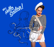 Smiling Beautiful Young Woman In Sailor Shirt With Rope, Octopus Drawing And Well Hello Sailor Inscription Isolated On Blue