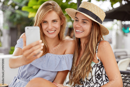 People Leisure Lifestyle And Modern Technology Concept Two Happy Lesbians Have Fun Outdoors