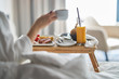 Leinwanddruck Bild - Breakfast in bed, cozy hotel room