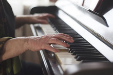 The Old Lady's Hands Playing Classical Music On The Piano At Home