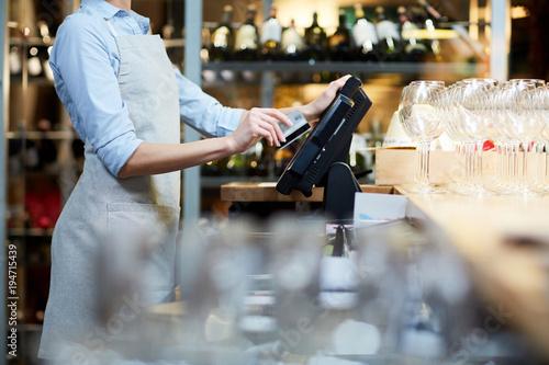 Pinturas sobre lienzo  Close-up of waitress registrating orders at the cash desk