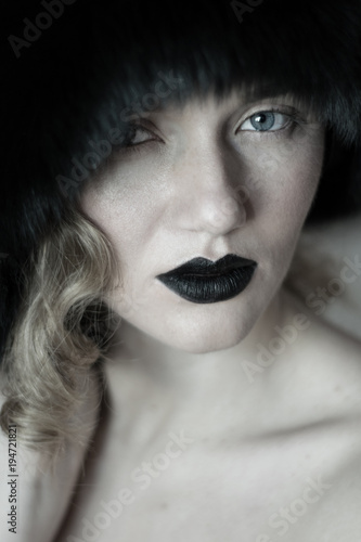 Printed kitchen splashbacks elegant woman with professional makeup and passionate look. Portrait of a beautiful blue-eyed girl with black lips and in black fur hat