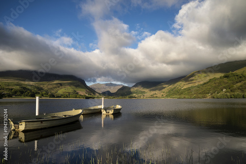 Poster Donkergrijs Landscape image of rowing boats on Llyn Nantlle in Snowdonia at sunset