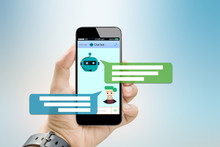 Chatbot Concept.Hands Holding ...