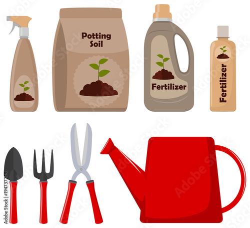 Fotografie, Obraz Set of gardening tools, potting soil, various fertilizers in bottles and spray gun