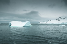 Pointed Iceberg In The Antarct...