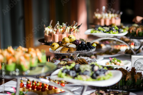 holiday buffet table served by different canape, sandwiches, snacks ready for ea Fototapete