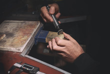 Jeweler Polishing Golden Chain With Rotary Tool, Closeup