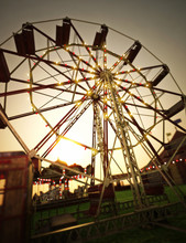 Carnival Midway Background With Ferris Wheel And Carousel . 3d Rendering