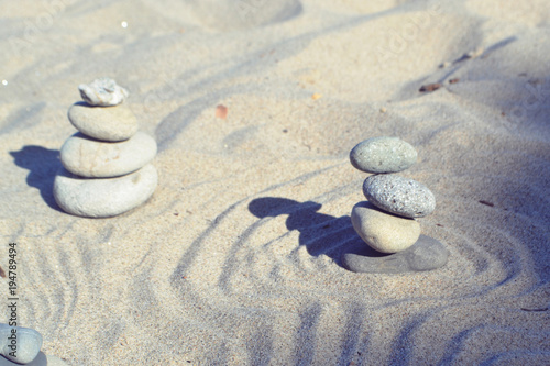 Balanced rocks in zen garden sand circles