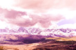 Beautiful view of the mountain range under the pink clouds. Mountain landscape in pastel colors