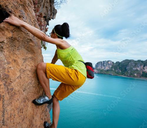 Teenage girl rock climbing - Stock Photo - Dissolve