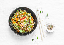 Pad Thai Vegetarian Vegetables Udon Noodles In A Light Background, Top View. Vegetarian Food In Asian Style