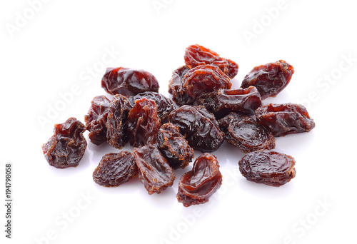 Raisins on a white background.