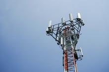 Communication Tower On Blue Sky