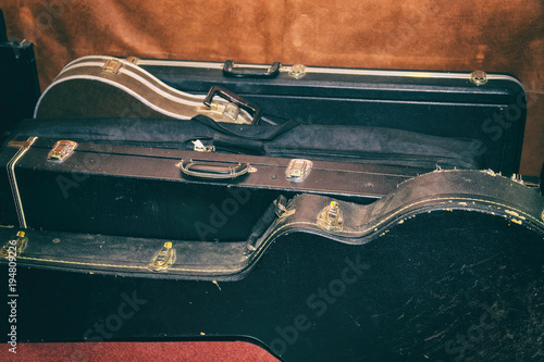 Photo A few Hard Cases for guitars Are At The Wall