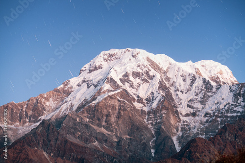Spoed Foto op Canvas Grijze traf. Snow-covered Annapurna mountain in the starry sky. Nepal, Himalayas