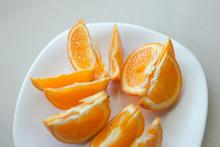 Orange On White Plate