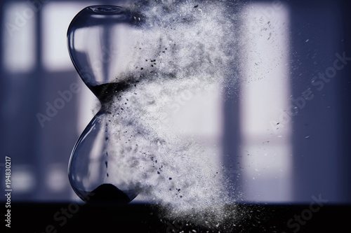Hourglass as time passing and pass away concept. Fototapet