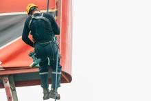 Industrial Climber Hangs A Pos...
