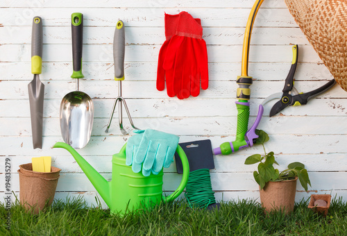 Fotobehang Tuin Gardening tools and utensils on green meadow, garden manteinance and hobby concept