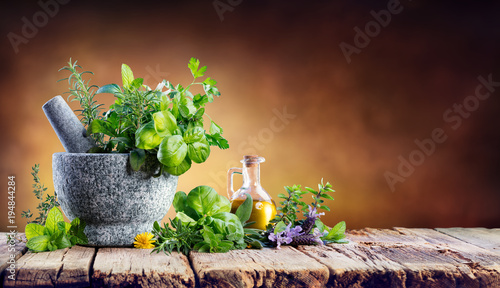 Foto op Aluminium Aromatische Aromatic Herbs With Mortar - Fresh Spices For Cooking