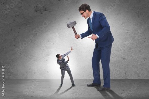 Cuadros en Lienzo Bad angry boss threatening employee with hammer