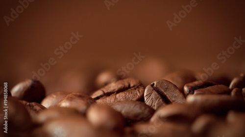 Fotobehang koffiebar macro of coffee beans in studioshoot on brown