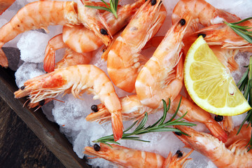 Fototapeta Raw fresh Prawns Langostino Austral. shrimp seafood with lemon and spices.
