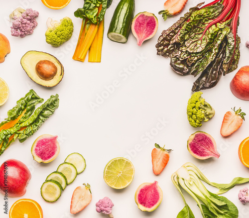Various healthy fruits and vegetables ingredients frame on white desk background, top view, flat lay. Healthy clean and detox, weight loss dieting or fasting  food concept Wall mural