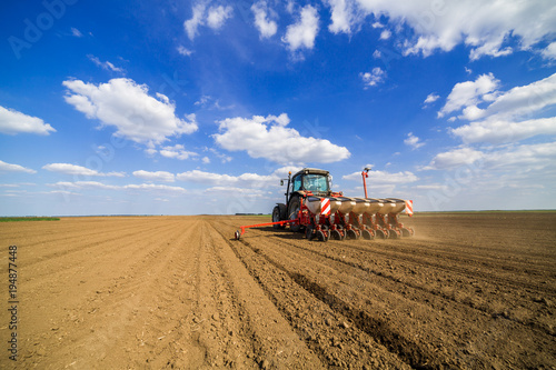 Fotografia Farmer seeding, sowing crops at field
