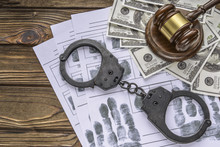 Concept Handcuffs With Hammer Of Judge And One Hundred Dollar Money Banknotes. Crime And Crime. Court. Fingerprints. Attacked Defendant