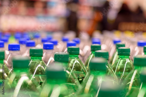 Picture lots of green bottles with the soda you only see the cover, selective fo Canvas Print