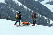 Ski Patrol Team Rescue Injured Skier With The Special Emergency Sledges In The Carpathian Mountains Region, Ukraine