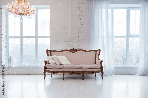 Vintage style sofa in loft interior room with big window. Wallpaper Mural